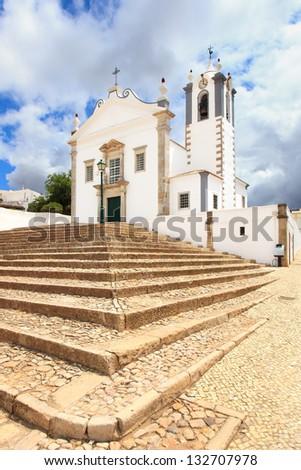 Portuguese Church landmark Igreja de Sao Martinho de Estoi as known as Matriz de Estoi, Faro province Algarve, Portugal - stock photo