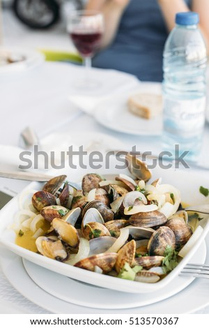 Portuguese Clams in garlic sauce (Ameijoas a Bulhao Pato) with onions served in Setubal, Portugal.
