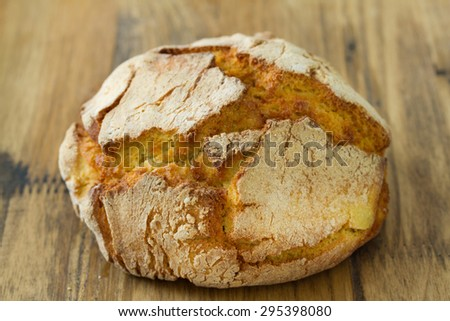 portuguese cornbread on brown wooden background