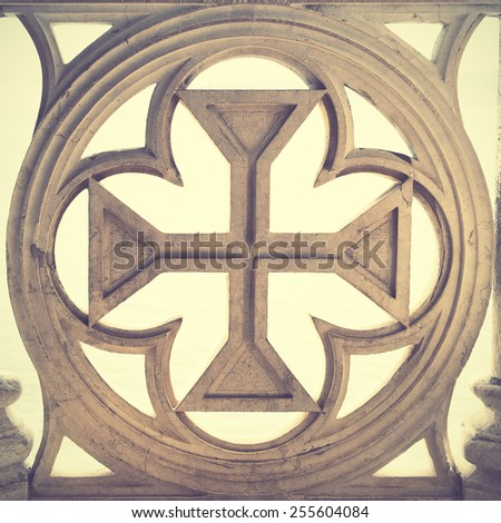 Portuguese cross. Retro style filtred image - stock photo