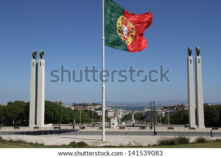 Portuguese flag flying on highpoint with views of Lisbon city