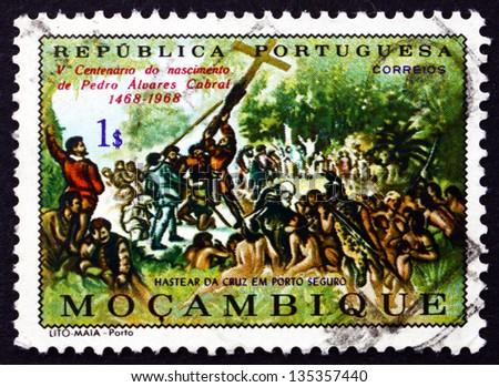 PORTUGUESE MOZAMBIQUE - CIRCA 1970: a stamp printed in the Portuguese Mozambique shows Raising the Cross at Porto Seguro, Pedro Alvares Cabral, circa 1970 - stock photo