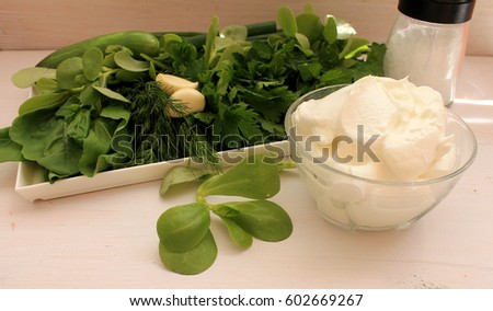Portulac, yoghurt and greens prepared for salad
