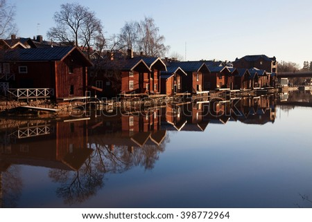 Porvoo, Finland. Classic old wood houses and their reflection in the river