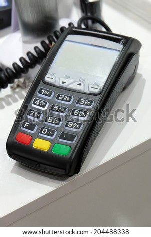 POS terminal on the table from above view - stock photo