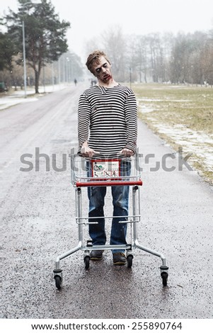 Posessed sailor man walking with a wagon - stock photo