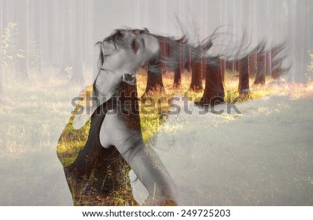 Posing girl with flowing hair in double exposure with evening forrest