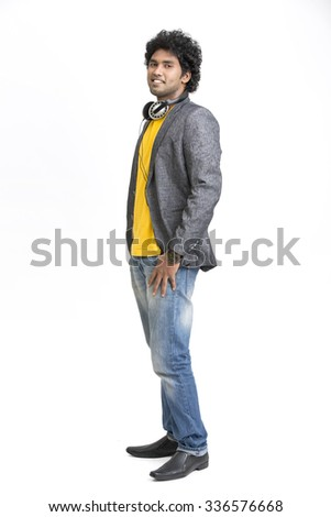 Posing happy Indian young urban man standing on white background. - stock photo