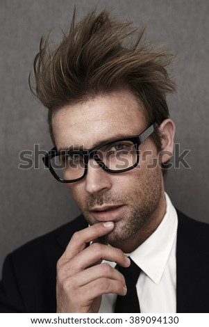 Posing messy haired businessman, portrait - stock photo