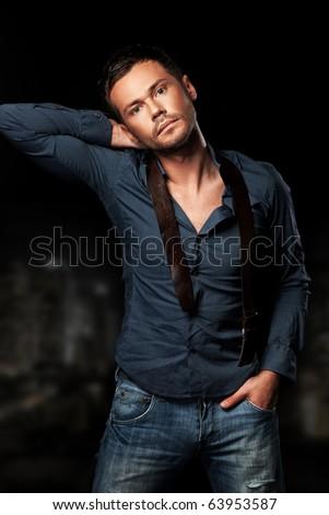 posing on dark background - stock photo