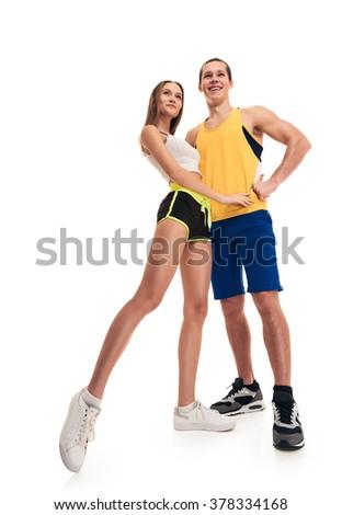 posing sporty fitness couple portrait full length - stock photo