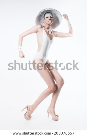 posing woman in white body and hat