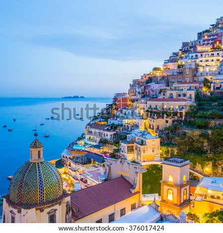 Positano, Amalfi Coast, Campania, Sorrento, Italy. View of the town and the seaside in a summer sunset - stock photo