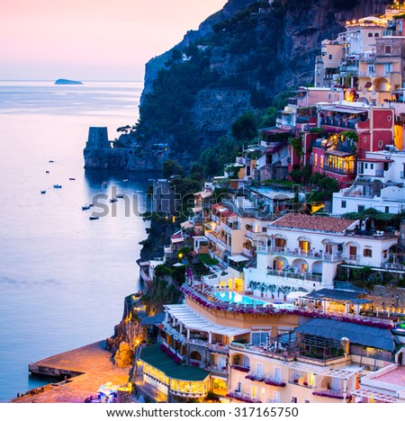 Positano, Amalfi Coast, sunset and lighs on the amazing town on the sea. Sorrento, Naples, Italy - stock photo