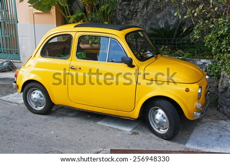 POSITANO - FEBRUARY 09: Fiat 500 parked on February 09, 2015 in Positano. Fiat 500 was one of the most produced European cars ever with 3,893,294 units manufactured in years 1957-1975. - stock photo