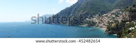 POSITANO, ITALY - JUNE 27: Long Panorama of Positano Town on JUNE 27, 2014. Picturesque Amalfi Coast Panoramic Landscape in Positano, Italy. - stock photo