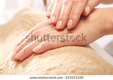 Position manicure, neat woman's hands.Treatment hand and nail care, the woman to a beautician for a manicure.  - stock photo