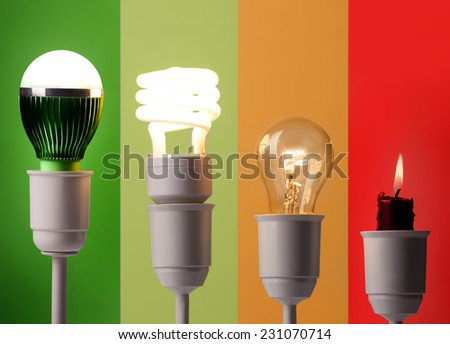 positioning of various lighting by energy savings and by colors - stock photo
