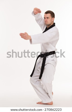 Positions of professional fighter in kimono on white background