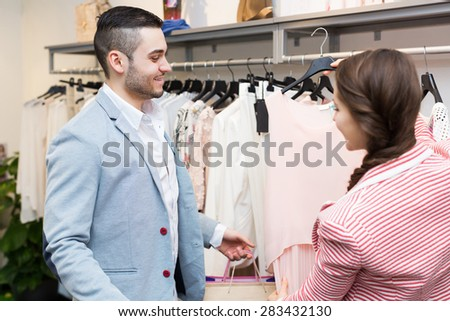 Positive adult spouses while shopping at boutique