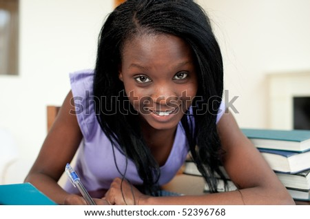 Positive Afro-american woman studying at home - stock photo