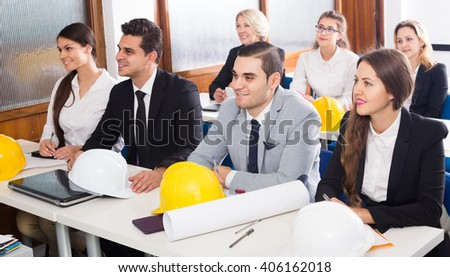 positive american architects having advanced training courses in classroom - stock photo