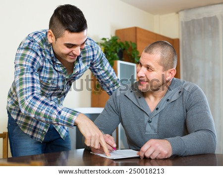 positive american friends  discussing tenancy agreement at new apartment