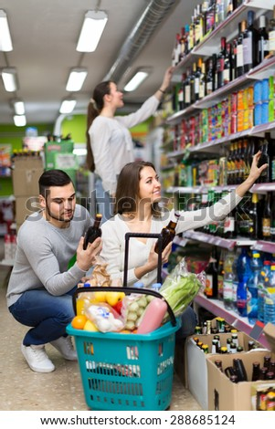 Positive  american people buying beverages for dinner at food shop - stock photo
