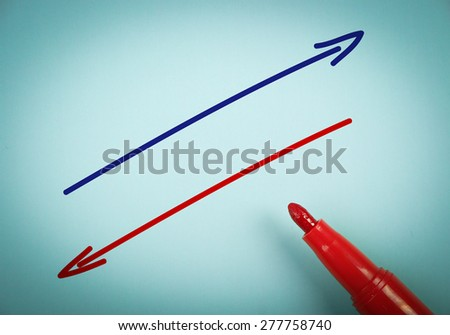 Positive and negative concept is on blue paper with a red marker aside. - stock photo