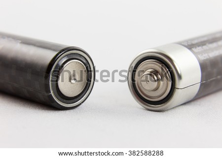 Positive and negative terminals of two batteries - stock photo