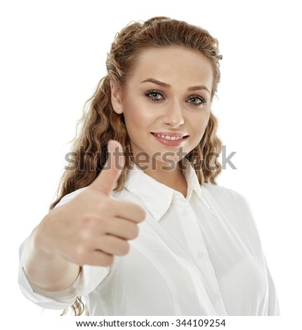 Positive beautiful businesswoman showing thumbs up sign isolated on white - stock photo