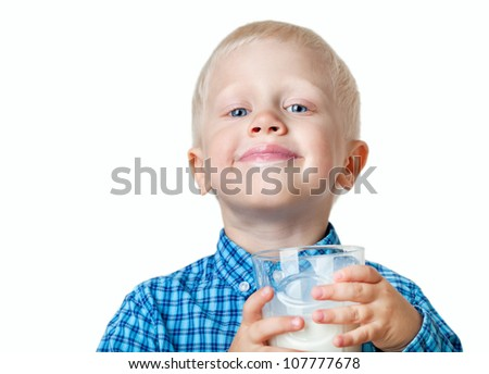 positive boy with glass of milk on a white background. - stock photo