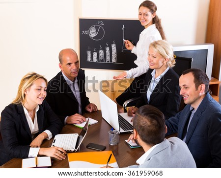 Positive brainstorming in modern office during conference call - stock photo