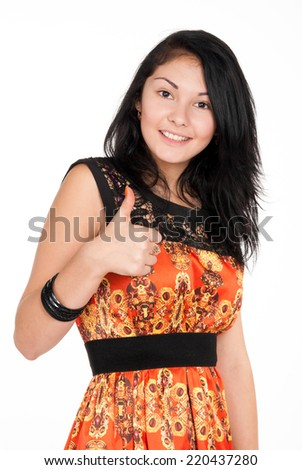 positive brunette shows lifts thumb on white background
