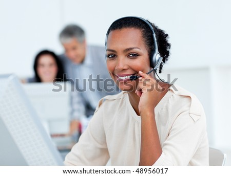Positive business partners working at computers in the office - stock photo