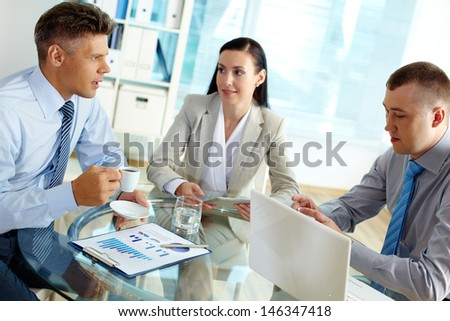 Positive business people discussing strategy or planning work in office - stock photo