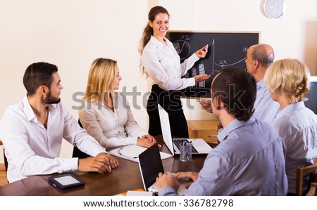 Positive business people during conference call indoors - stock photo