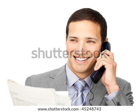 Positive businessman on phone holding a newspaper against a white background