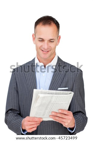 Positive businessman reading a newspaper against a white background