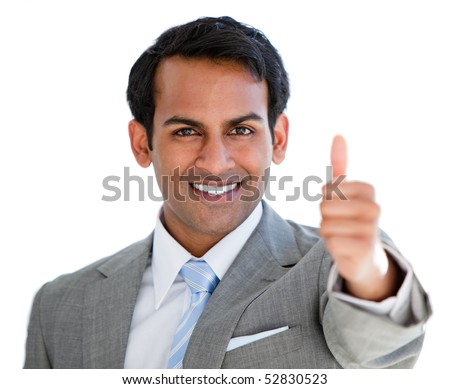 Positive businessman with a thumb-up sign in the office - stock photo