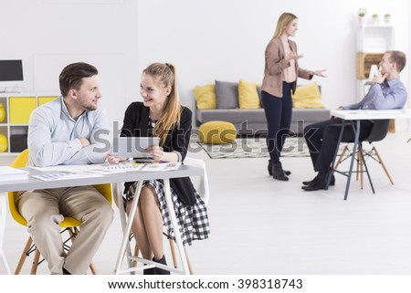 Positive businesspeople working together in light, spacious and modern office
