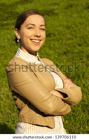 Positive businesswoman looking at the camera. outdoors - stock photo