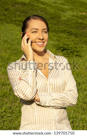 Positive businesswoman talking on mobile phone - stock photo