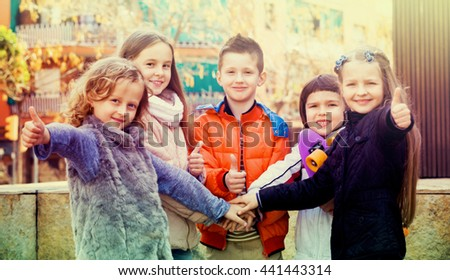 Positive cheerful children holding hands and giving friendship vow - stock photo