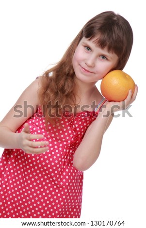 Positive child holding a yellow grapefruit