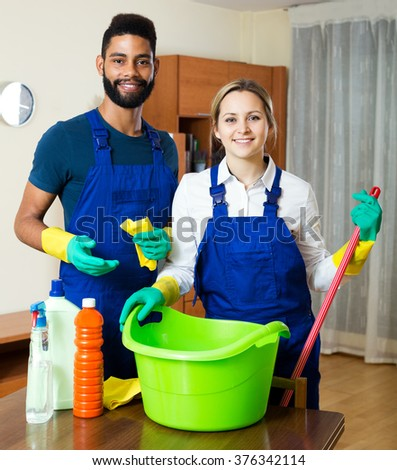 Positive cleaners cleaning and dusting in ordinary house