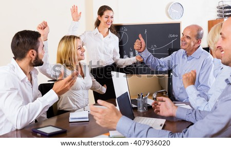 Positive colleagues discussing price development in the office  - stock photo