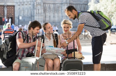 positive european tourists with map exploring the city destination