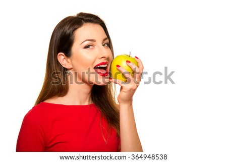 Positive Female Biting a Big Green Apple Fruit Smiling on White - stock photo