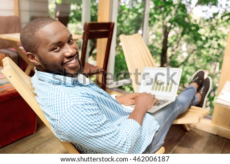 Positive handsome man sitting in the chair